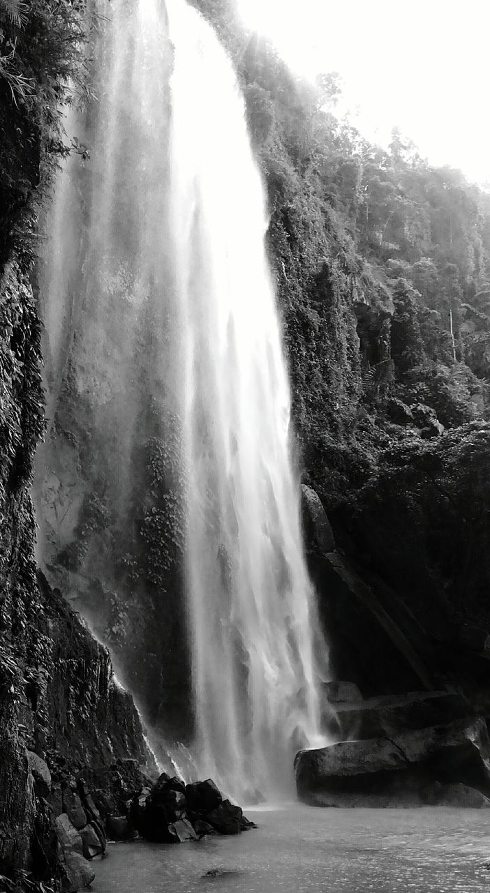 waterfall, water, nature, rock formation, motion, beauty in nature, rock - object, scenics, day, long exposure, outdoors, travel destinations, tourism, no people, cliff, physical geography, tranquility, power in nature, low angle view, sky
