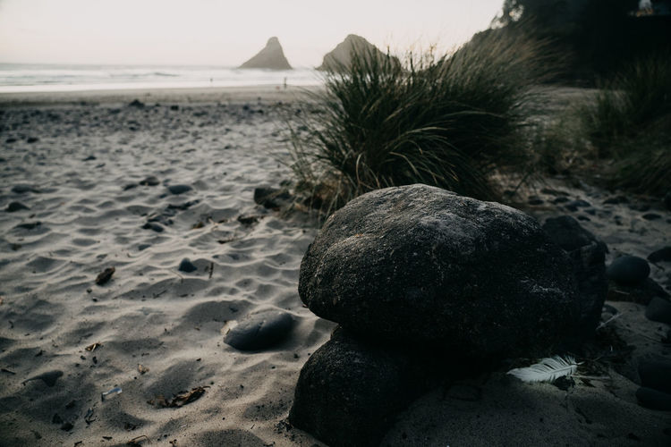 Beach Oregon Oregon Coast Pacific Northwest  Land Sea Water Sand Tranquility Nature No People Focus On Foreground Tranquil Scene Rock Solid Beauty In Nature Coastline Coast Close-up Day Rock - Object Scenics - Nature Pebble Outdoors Sky