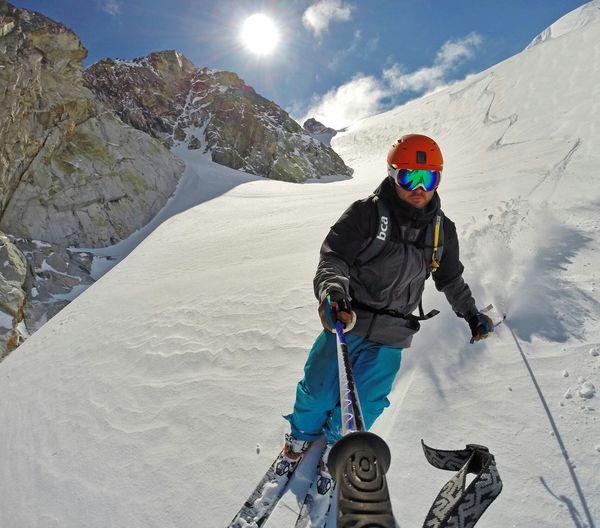 Man taking selfie while skiing