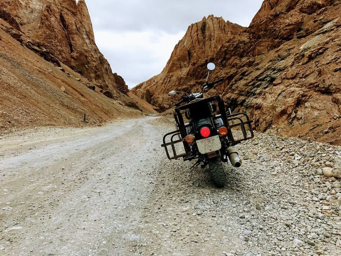 Transportation Land Vehicle Rock - Object Mode Of Transport Day Mountain Real People Outdoors Nature Sky Beauty In Nature One Person People