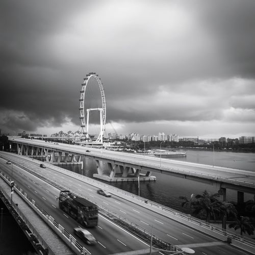 High angle view of highway against cloudy sky