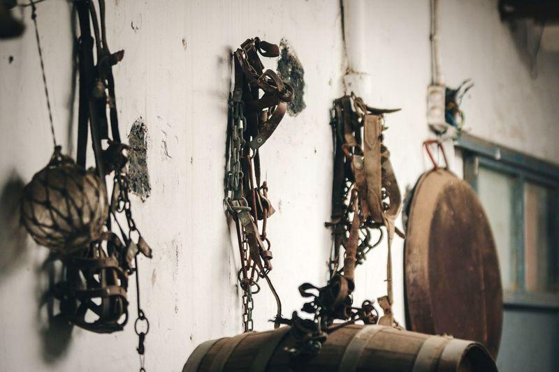 Metallic equipment hanging on wall in store room