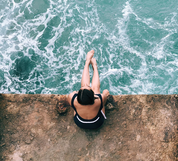 High angle view of man relaxing in sea