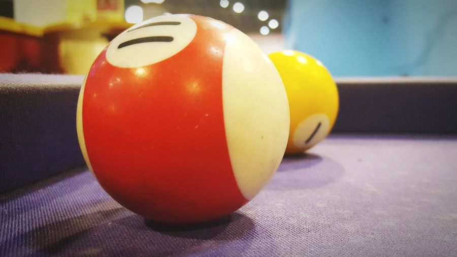 Close-up of multi colored ball on table