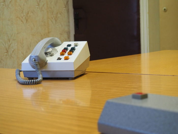 Old-fashioned telephone on wooden table