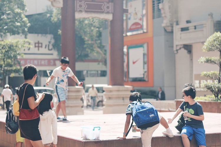 Real People Playing Outdoors Medium Group Of People Boys Childhood Student Leisure Activity Hanging Out