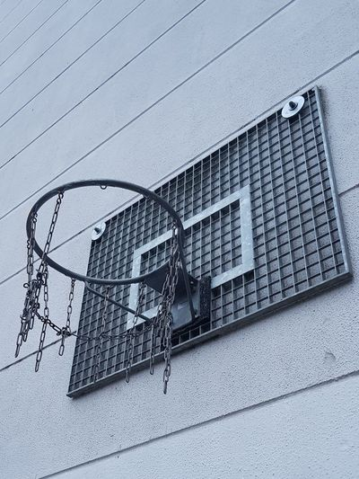 Low angle view of basketball hoop against building