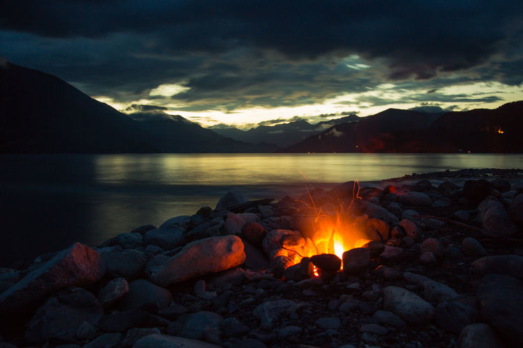 Sunset on Slocan Lake Camp Fire Beach Beauty In Nature British Columbia Campfire Carpenter Creek Cloud - Sky Fire Lake Landscape Long Exposure Moody Mountain Mountains Nature Night No People Outdoors Rocky Mountains Scenics - Nature Slocan Lake Sunset Tranquil Scene Tranquility Water