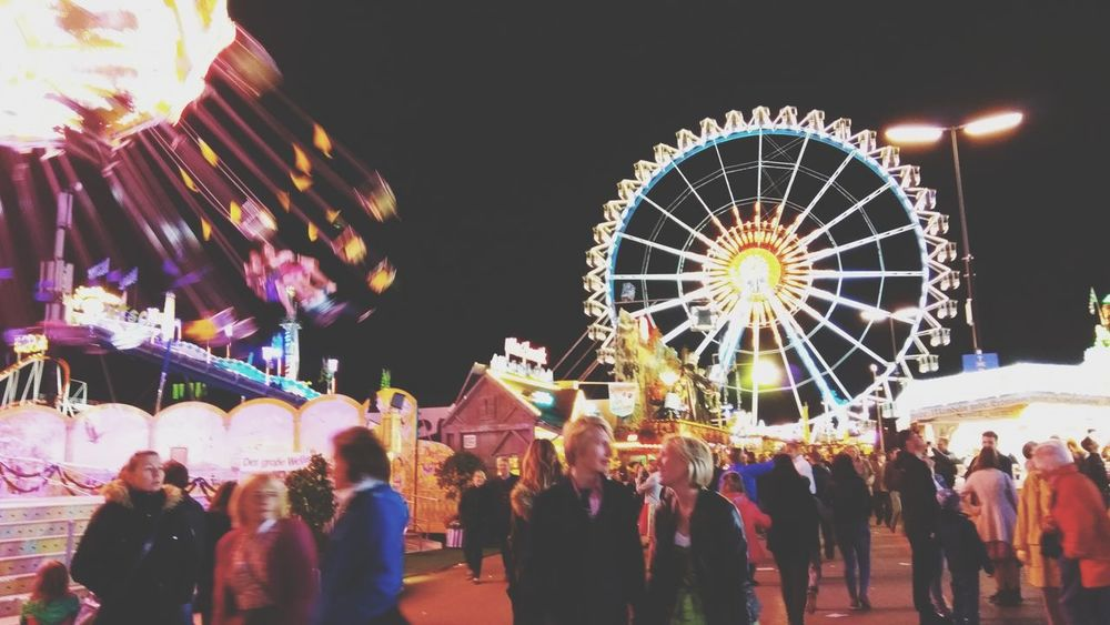 Oktoberfest 2017 Wiesn Muenchen Munich Fair Beer Fest Amusement Park Illuminated Ferris Wheel Celebration Arts Culture And Entertainment Night Fun Holiday - Event Leisure Activity Enjoyment Excitement Amusement Park Ride Traditional Festival People Large Group Of People Vacations Multi Colored Outdoors Nightlife