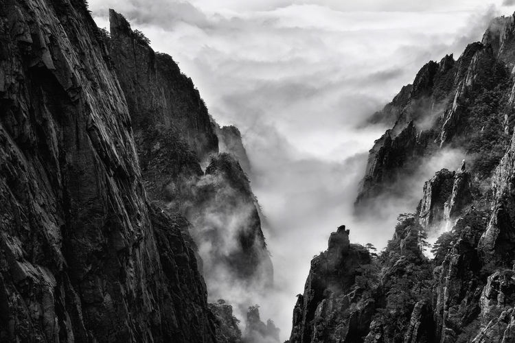 One fine day up on Huangshan, China photographed by Shawn Towne Beauty In Nature China Cliff Cloud Cloud - Sky Cloudy Day Geology Huangshan Idyllic Landscape Low Angle View Mountain Mountain Range Nature No People Non-urban Scene Outdoors Physical Geography Remote Rock - Object Rock Formation Rocky Mountains Scenics Tranquility
