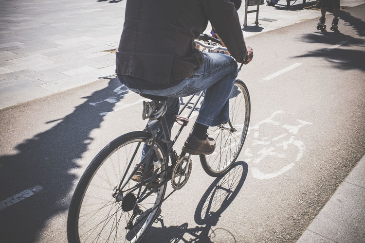 Adult Adults Only Bicycle City Close-up Cycling Day Human Body Part Human Leg Leisure Activity Lifestyles Low Section Men One Man Only One Person Only Men Outdoors People Shadow Sunlight Transportation Young Adult