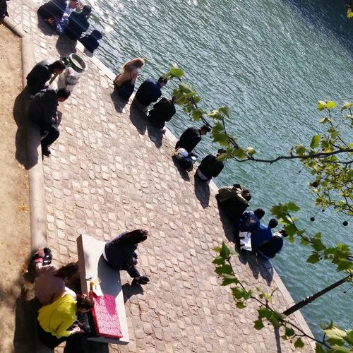 .Paris, People by Seine River, Ile Saint Louis.Today. Paris, France  Paris Je T Aime Paris ChampsElyseesParis River Seine La Seine Walking Along The Seine Ilesaintlouis