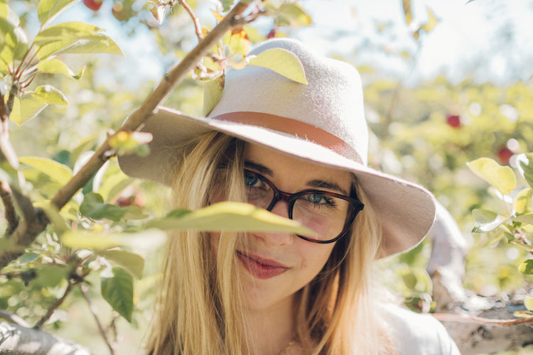 Beautiful Woman Close-up Day Eyeglasses  Focus On Foreground Front View Hat Headshot Leisure Activity Lifestyles Looking At Camera Nature One Person Outdoors Portrait Real People Tree Young Adult Young Women