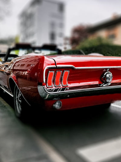 Close-up of red car in city