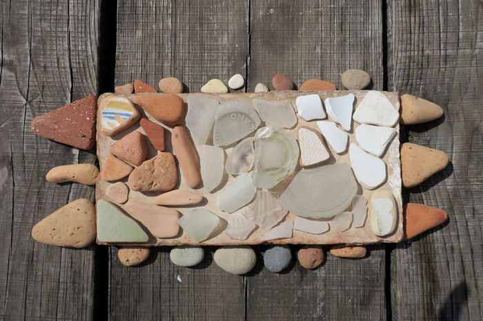 gathered pebbles, glass and tiles Mosaic Close-up Directly Above Glass - Material High Angle View Large Group Of Objects No People Pattern Pebbles And Stones Playful Table Tile White Color Wood - Material