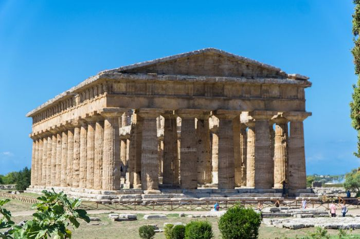 Paestum Roman ruins, Italy Roman Ruins Temple History The Past Architecture Ancient Travel Destinations Architectural Column Sky Archaeology Building Exterior Travel Ancient Civilization Nature Place Of Worship Built Structure Clear Sky Old Ruin Tourism Blue Day Plant