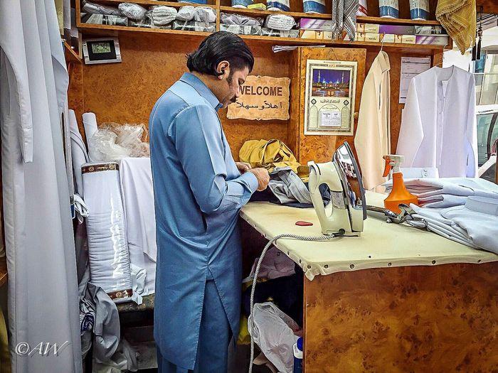 The Shop Around The Corner Shop Tailor Tailoring Kandora Kandoora Handcraft Traditional Traditional Culture Traditional Clothing Emarati United Arab Emirates Shoparoundthecorner Finetailoring Ironing Abudhabi The Street Photographer - 2016 EyeEm Awards The Portraitist - 2016 EyeEm Awards