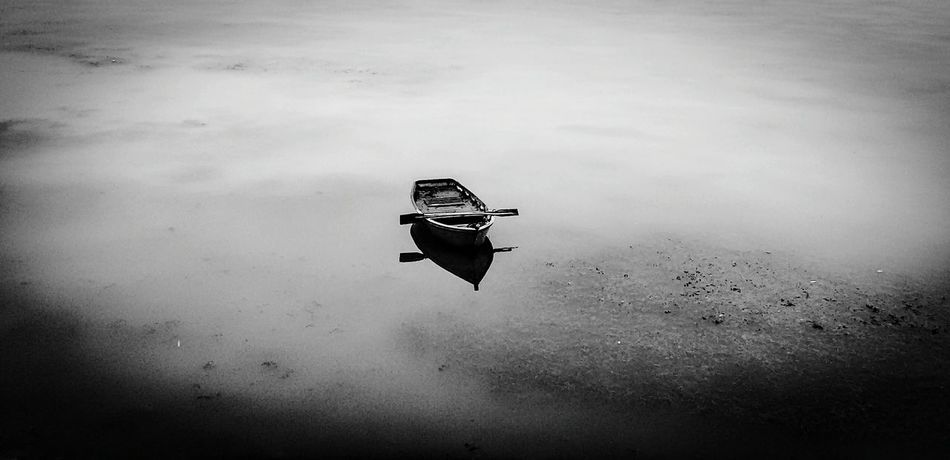 it ws a beautiful evening and i with some of my friends had gone to sukhna lake, a local tourist spot in chandigarh , india.....bt some part of lake had become partially dry due extremly hot summers....and there i saw this boat in partial water.. Boat Dry Lake Black And White Casual Shot Tranquility India_clicks Sukhna Lake Chandigarh