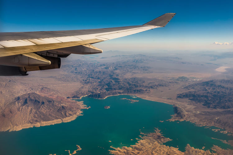 View over Lake Mead, Nevada Air Vehicle Airplane Beauty In Nature Scenics - Nature Aircraft Wing Transportation Water Mode Of Transportation Aerial View Flying Nature Mid-air Sky Travel Landscape Plane Plane View Lake Mead Nevada Las Vegas Lake Mead National Recreation Area Vacations USA America
