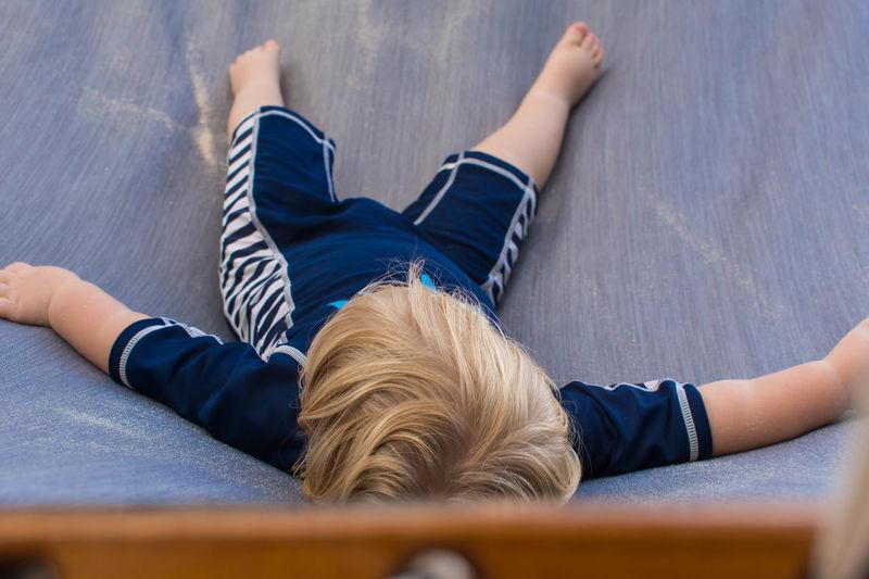 High angle view of baby boy lying on hammock