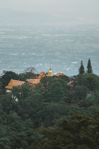 Golden pagoda high up the mountains of Chiang Mai. Buddhist Buddhist Temple In Thailand Chiang Mai Cityscape Doi Suthep Doi Suthep Temple Mountain View Pagoda Travel Photography Ancient Civilization Beauty In Nature Buddhist Temple Building Hidden Behind Tree Drone Photography Golden Pagoda Greenery High View Of The City Landscapes No People Religion Spirituality Tourist Destination Travel Destinations Tree Trees And Sky EyeEmNewHere