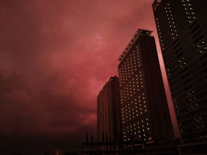 City Illuminated Urban Skyline Skyscraper Modern Red Sunset Sky Architecture Built Structure Dramatic Sky Storm Cloud Sky Only Thunderstorm Cityscape Tall - High Residential Structure Moody Sky Cloudscape Cyclone Power In Nature Torrential Rain Storm Overcast Atmospheric Mood Tower