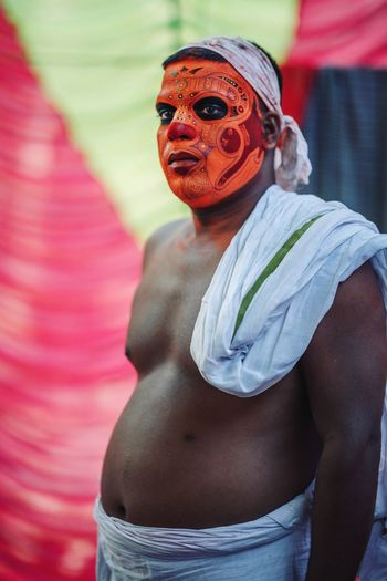 Theyyam of Kannur - Kerala / India Portrait Of A Man  Portrait Photography Portrait PortraitPhotography India Indian Indian Culture  Kerala India Kerala Theyyam Indiaclicks Theyyams Of Kannur Festival Tradition Rite Portraits Kerala, India Kannur Kannurphotos One Person Representation Waist Up Real People Focus On Foreground Arts Culture And Entertainment Creativity Art And Craft Lifestyles Multi Colored Three Quarter Length