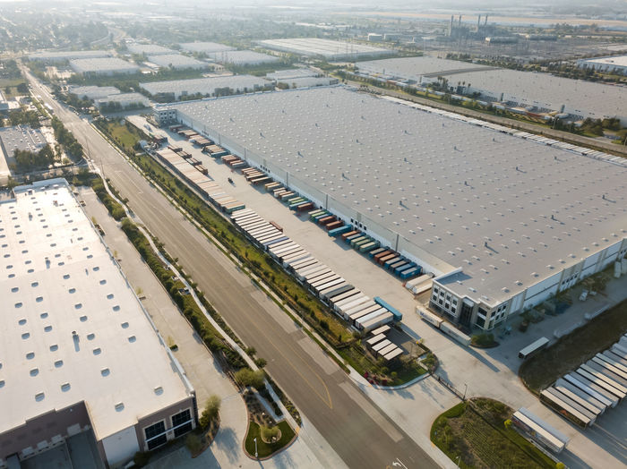 Warehouse distribution centers High Angle View Day Architecture Building Exterior Built Structure Transportation Nature Aerial View Outdoors Environment Industry Mode Of Transportation City Land Vehicle Warehouse Distribution Logistics Trailers Transportation