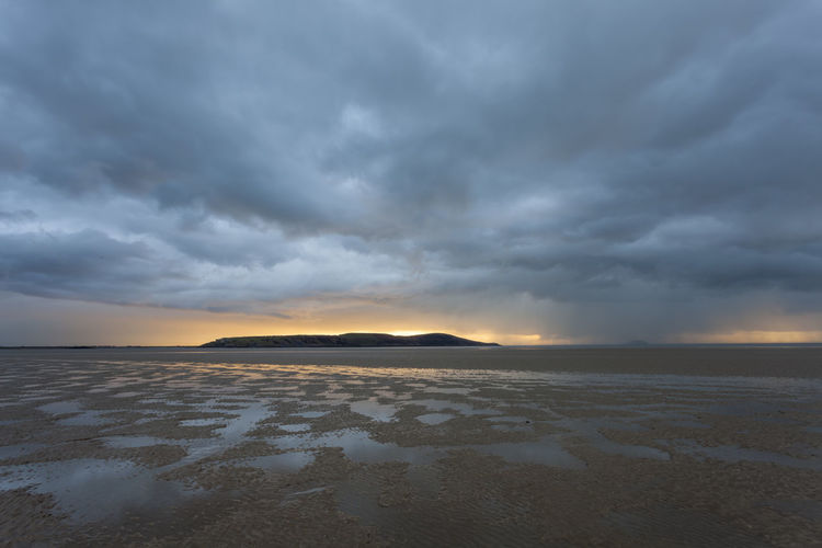 Stormy Sunset Brean Down Weston-super-mare Beach Beauty In Nature Cloud - Sky Environment Evening Idyllic Land Landscape Low Tide Nature No People Non-urban Scene Overcast Scenics - Nature Sea Sky Storm Cloud Stormy Sunset Tranquil Scene Tranquility Water