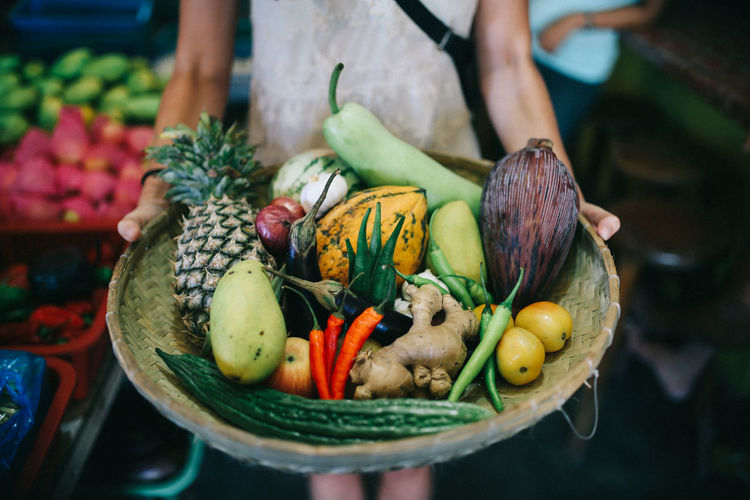 Food Food And Drink One Person Freshness Healthy Eating Vegetable Midsection Fruit Wellbeing Choice Real People Holding Human Hand Day Focus On Foreground Variation Standing Hand Container Outdoors Preparing Food Basket ASIA Freshness