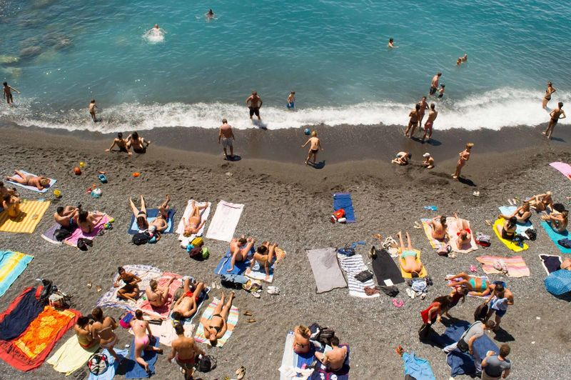 High angle view of people relaxing on beach