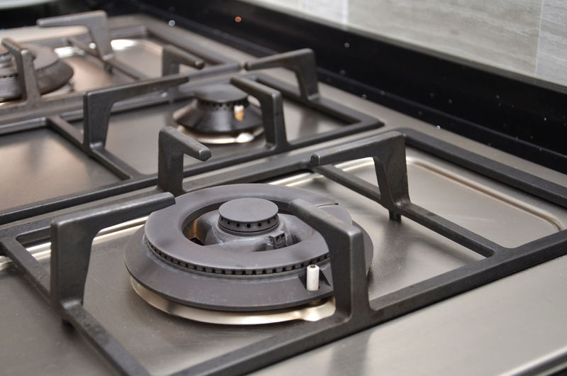 Close-up of gas stove in kitchen