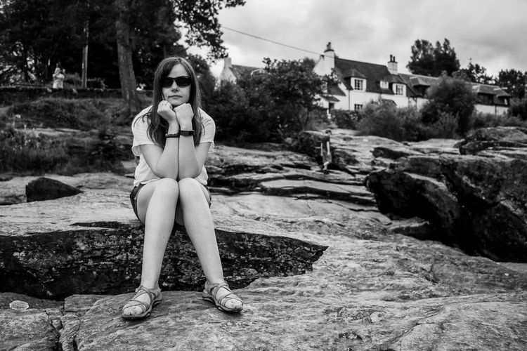 Lomography Blackandwhite One Person Full Length Real People Front View Young Adult Leisure Activity Lifestyles Portrait Young Women Day Sitting Nature Rock Outdoors