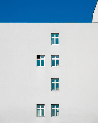 Facade Architecture Built Structure Window Building Exterior Building No People Day Outdoors Fujix_berlin Ralfpollack_fotografie Minimalism Minimalist Photography  Wall - Building Feature White Color Copy Space Residential District Close-up Clear Sky Apartment Shape Sunlight Blue