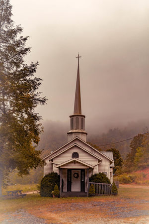 Beautiful mountain side church I came across in Tennessee while traveling through the smokey mountains. I love how it seems like it is in the clouds. Architecture Building Exterior Built Structure Church Church Churches Clear Sky Clouds Clouds And Sky Flag Historical Building History Ladyphotographerofthemonth Low Angle View Mountain_collection Mountains Outdoors Place Of Worship Religion Sky Spirituality Street Light Tower Travel Week