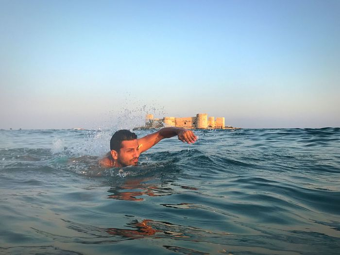 Kız Kalesi beach Water Sea Sky One Person Real People Lifestyles Leisure Activity Swimming Waterfront Nature Motion Splashing Men Clear Sky Beauty In Nature Outdoors Trip Vacations Horizon Over Water Human Arm