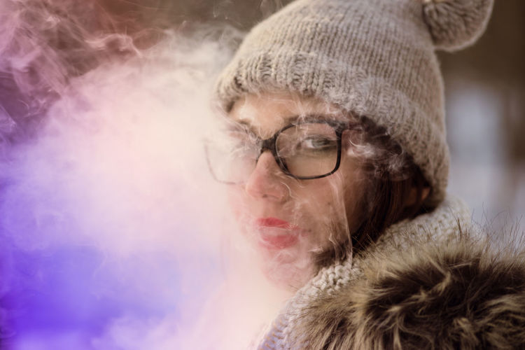 Smoking Adult Close-up Colorful Smoke Day Eyeglasses  Indoors  One Person People Real People Vape Warm Clothing Young Adult