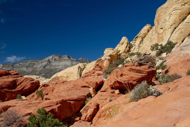Scenic view of rocky mountains against clear blue sky. red rock canyon, nevada