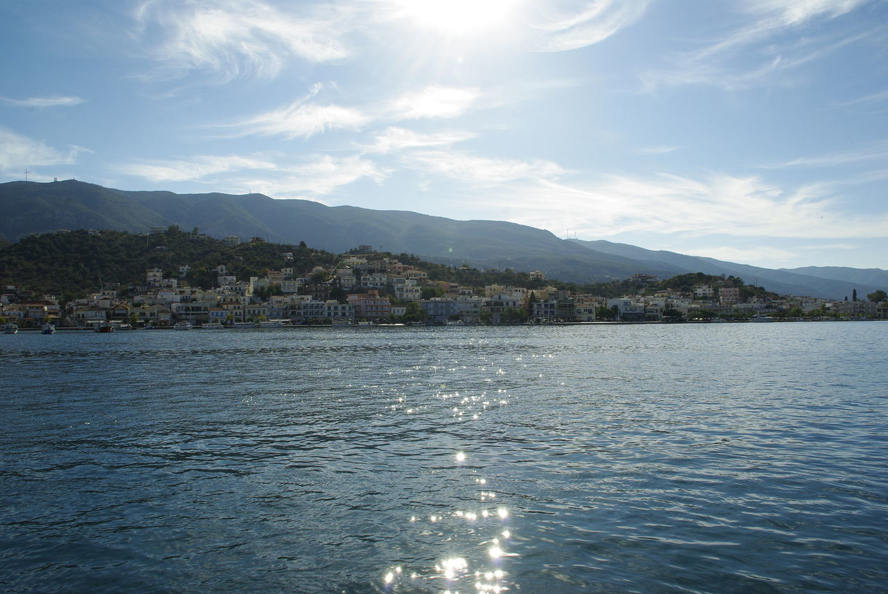 Water reflections in the port of Poros Poros Sun Reflection On Water Sunlight Architecture Built Structure Cloud - Sky Day House Mountain Range No People Scenics Sea Seascape Sky Sun Sun Reflections Sunshine View Into Land Water Waterfront