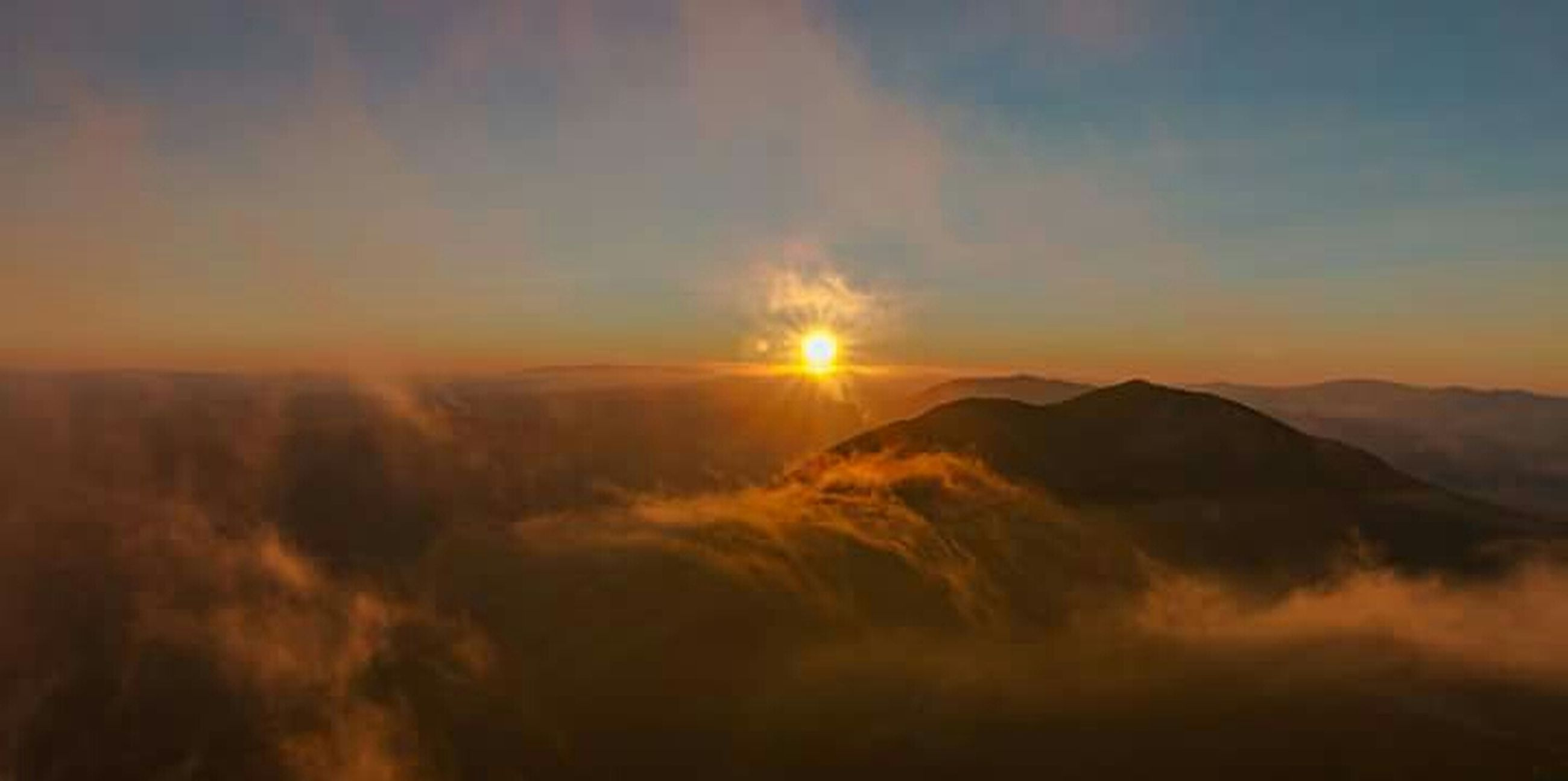 scenics, mountain, nature, mountain range, landscape, beauty in nature, outdoors, sky, sunset, cloud - sky, smoke - physical structure, no people, night, erupting, astronomy