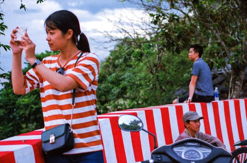 I've spent last December/January photographing Vietnam from North to South on film - while the final series is not going to be published for some time, I'm sharing here some of my favourite extras that didn't make it to the final selection. Stripes Vintage ASIA Vietnam Film Photography Analogue Photography Real People Streetphotography My Best Photo Friendship Men Flag Striped Women Smiling Sky