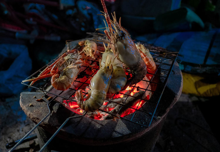 Shrimp grill. Heat - Temperature Burning Fire - Natural Phenomenon Fire Food Food And Drink Barbecue Campfire Preparing Food Camping Firewood Wood - Material Meat Flame Bonfire