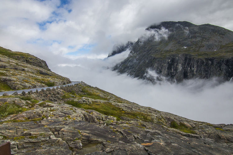 View on Clouds against mountain and sky Norway Beauty In Nature Cloud - Sky Cold Temperature Day Environment Idyllic Landscape Mountain Mountain Range Nature No People Non-urban Scene Outdoors Rock Scenics - Nature Sky Tranquil Scene Tranquility Travel Destinations Trollstigen