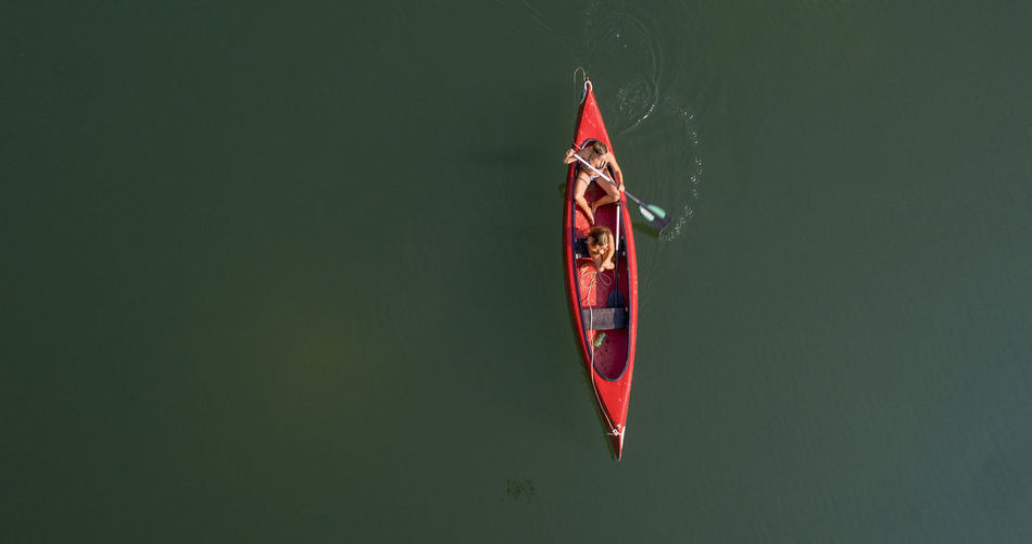 People canoeing in lake