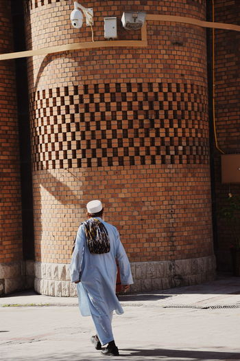 Headwear Full Length Rear View Walking Human Back Back Traditional Clothing Men Place Of Worship Architecture