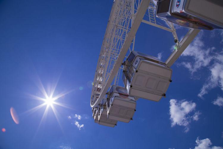 Cropped image ferris wheel against blue sky