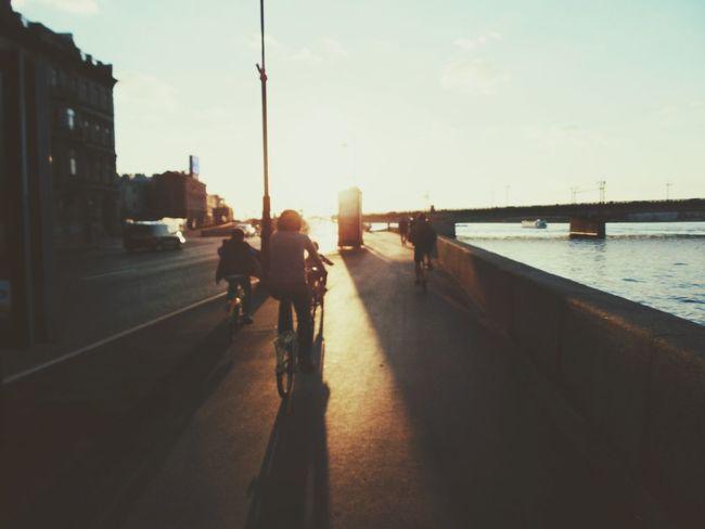 City Water Biker Bridge - Man Made Structure Bicycle Road Sunlight Men Cycling River Street Light Land Vehicle Vehicle