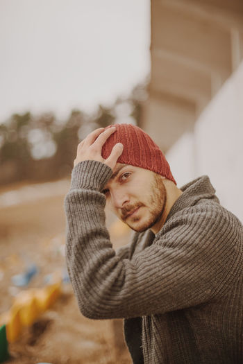 Casual Clothing Clothing Focus On Foreground Front View Hat Knit Hat Leisure Activity Lifestyles Men Obscured Face One Person Portrait Real People Scarf Standing Sweater Waist Up Warm Clothing Winter Young Adult The Portraitist - 2018 EyeEm Awards