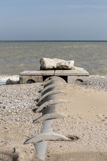 cement discharge tube on the beach Sea Polluted Water Pollution Environment Nature Horizon Over Water Sand Pipe - Tube Discharge Cement Urban Skyline Adriatic Sea Coastline Sewer Liquid Waste Old No People Tube Rough Sea