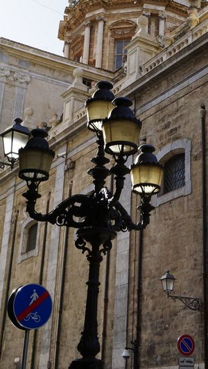 Street post light. Palermo, Sicily, Italy. Traffic Sign Street Sign Street Streetphotography Street Post Pole Light Palermo Sicily Italy Photo Photographer Sony Sony A6000 Sonyalpha Travel Travel Destinations Architecture_collection Photography Architectural Detail Old Buildings City Architectural Column Architecture Building Exterior Built Structure Historic One Way No Parking Sign Traffic Arrow Sign Pedestrian Crossing Sign